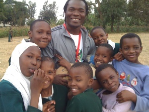 ARDP founder Juma Kittyler with at-risk kids at Arusha school.