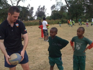 Yes! Tanzania trustee Lewis Patience helps Kittyler teach  ARDP kids.