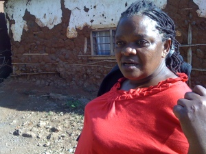 "Mama Kishe on a ""social reality tour"" of Moshi's Kaloleni slum."