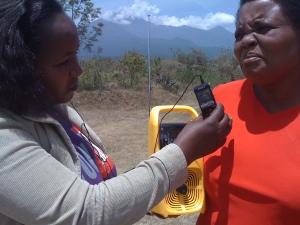 Fahari Yangu host Clara Moita interviewing farmer Esther Mbwana.
