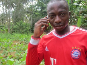 Ali Abeid calls his friend and fellow young farmer Adam from Shinyanga on Tanzania's mainland