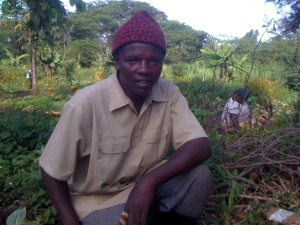 John Melaulaizer takes a pause from work on the Kesho Leo farm