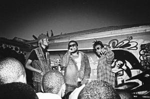 Arusha hip hop producer Daudi Bakari, aka Daz Naledge, hypes up the crowd at Saving Underground Artists (S.U.A.) event. Credit: Loic Nogues