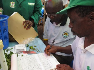 Crop doctor Wilson Mchomvu writes out his prescription for the unhealthy sweet pepper