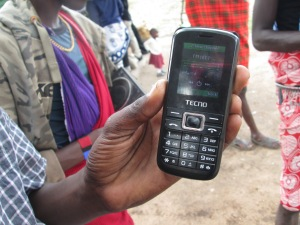 Mindey Ndoinyo with his mobile tuned into Loliondo FM
