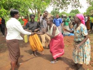 Sarah Adongo shaking hands with women