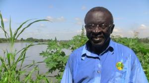 Wilson along bank of Nile River where WVA garden is located