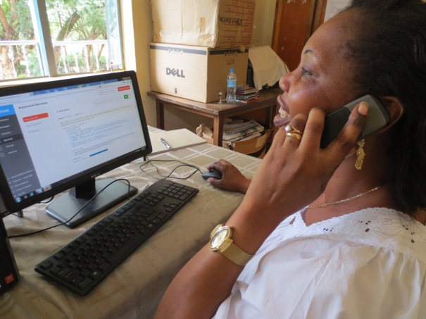 Helen Madege of Radio Sauti ya Injili demonstrating the Beep4Weather service.