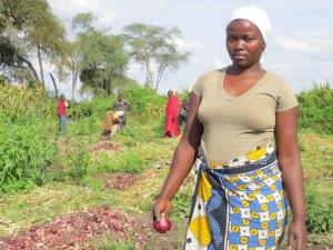 25-year-old Tanzanian onion farmer Juliana Amadeus pauses from her work in Kirya village, a semi-arid region of northern Tanzania.
