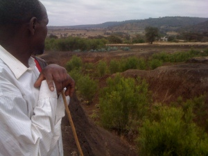 Mixed farmer, Jeremiah Chuma looking out over the Korongo or canyon that cuts across his land like a knife wound.