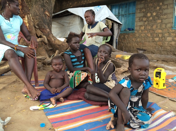 A Murle family from Pibor, an administrative area located within Jonglei state of South Sudan, listens to My Mahad