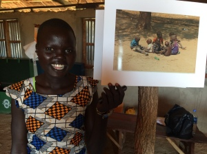 Rebecca Yar Achiek showing off one of her photos