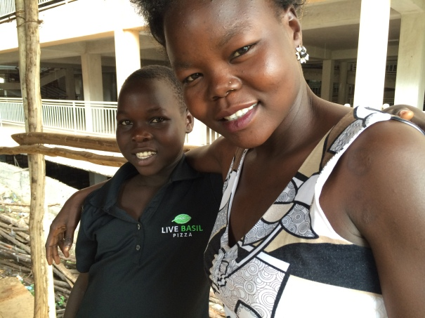 Betty Asha with Viola, a 12-year-old refugee rescued from Pukuka village.