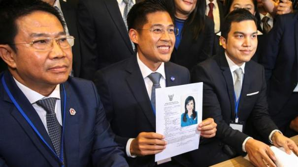 Thai Raksa Chart party leader Preechapol Pongpanich holds up an application for Princess Ubolratana to run as prime ministerial candidate. The party now faces a ban [Athit Perawongmetha:Reuters]